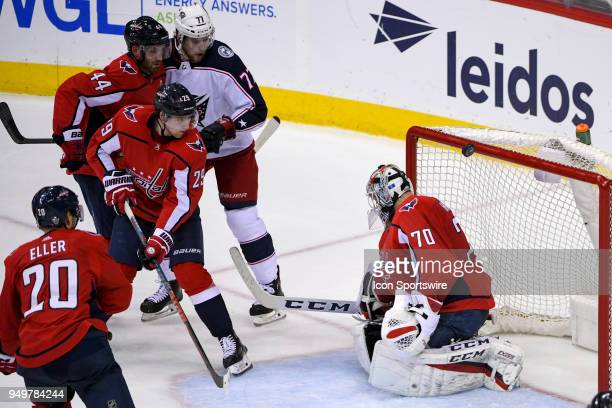 Washington Capitals goaltender Braden Holtby makes a third period save agains the Columbus Blue Jackets on April 21 at the Capital One Arena in...