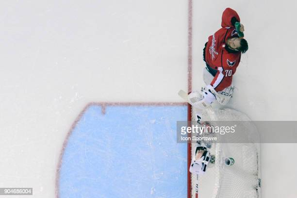 Washington Capitals goaltender Braden Holtby pours water on his head at the start of the game against the Carolina Hurricanes on January 11 at the...