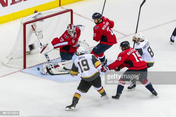 Washington Capitals goaltender Braden Holtby reaches to make save on shot by Vegas Golden Knights right wing Reilly Smith as Washington Capitals...