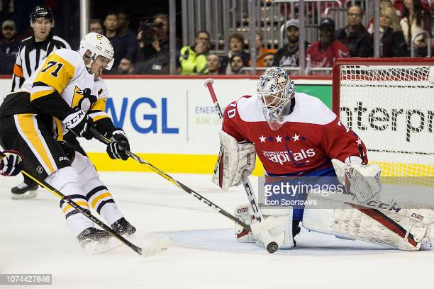 Washington Capitals goaltender Braden Holtby saves on a shot by Pittsburgh Penguins center Evgeni Malkin in the first period during a NHL game...