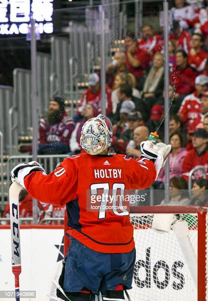 Washington Capitals goaltender Braden Holtby sprays water in the air in the first period during the game against the Detroit Red Wings on December 11...