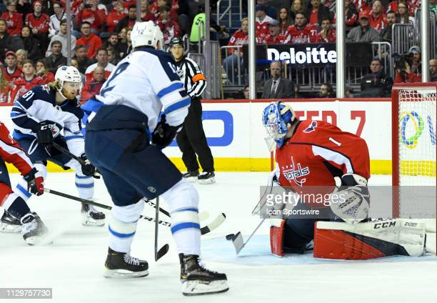 Washington Capitals goaltender Pheonix Copley makes a first period on a shot by Winnipeg Jets left wing Kyle Connor on March 10 at the Capital One...