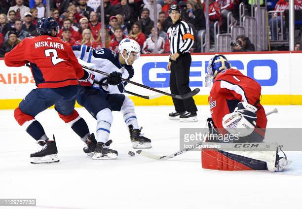 Washington Capitals goaltender Pheonix Copley makes a first period save on a shot by Winnipeg Jets left wing Brandon Tanev on March 10 at the Capital...