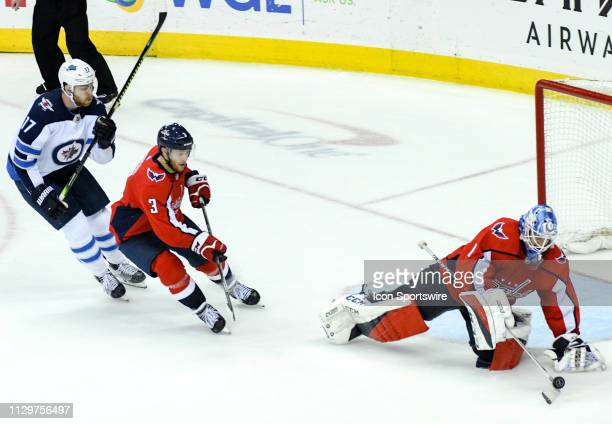Washington Capitals goaltender Pheonix Copley makes a third period save against Winnipeg Jets center Adam Lowry on March 10 at the Capital One Arena...