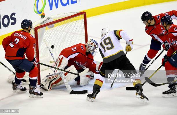 Washington Capitals goaltender Philipp Grubauer and the rest of the Caps defense cannot stop the shot on goal by Vegas Golden Knights right wing...