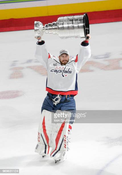 Washington Capitals goaltender Philipp Grubauer hoists the Stanley Cup after his team defeated the Vegas Golden Knights 43 in Game Five of the 2018...