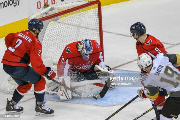 Washington Capitals goaltender Philipp Grubauer makes a save on a shot by Vegas Golden Knights right wing Reilly Smith aided by defenseman Matt...