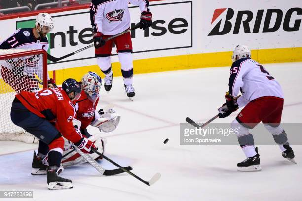 Washington Capitals goaltender Philipp Grubauer makes a save on shot by Columbus Blue Jackets center Mark Letestu on April 15 at the Capital One...