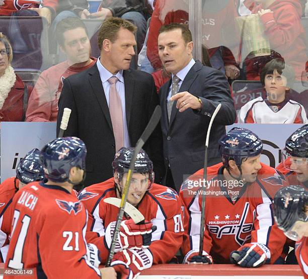 Washington Capitals head coach Adam Oates talks with assistant Calle  Johansson during a second period time a869be960a93
