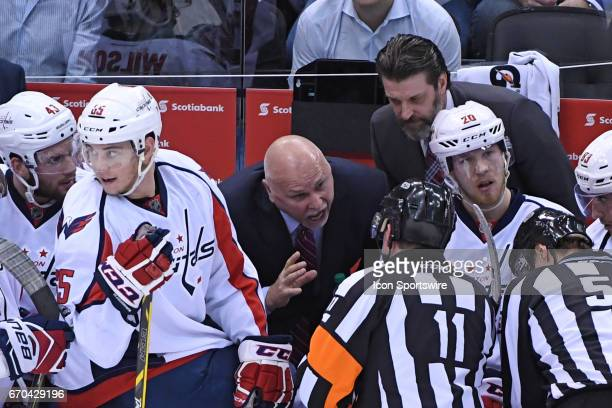 Washington Capitals Head Coach Barry Trotz debates a call with Referee Kelly Sutherland during to the Round 1 Game 4 of the NHL Stanley Cup Playoffs...