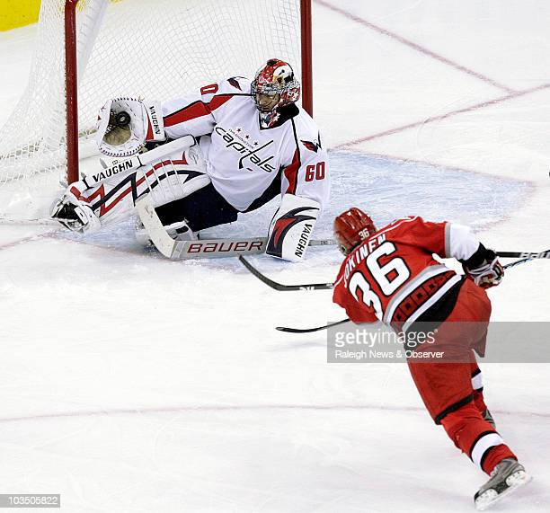 Washington Capitals' Jose Theodore makes a glove save on a shot by the Carolina Hurricanes' Jussi Jokinen during secondperiod action at the RBC...