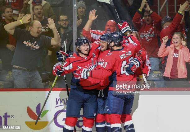 Washington Capitals left wing Alex Ovechkin after scoring unassisted celebrates with center Nicklas Backstrom and right wing Tom Wilson during a NHL...