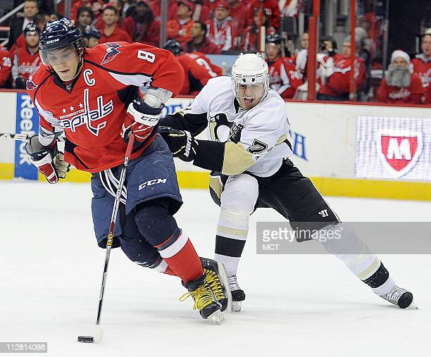Washington Capitals left wing Alex Ovechkin and Pittsburgh Penguins center Evgeni Malkin battle for the puck during the 1st period of their NHL game...