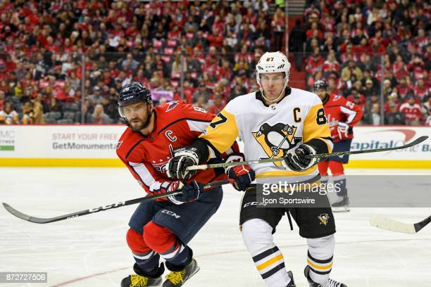 Washington Capitals left wing Alex Ovechkin and Pittsburgh Penguins center Sidney Crosby fight for a second period puck on November 10 at the Capital...