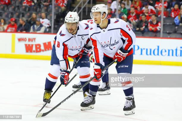 Washington Capitals left wing Alex Ovechkin and Washington Capitals defenseman Nick Jensen during the first period of the National Hockey League Game...
