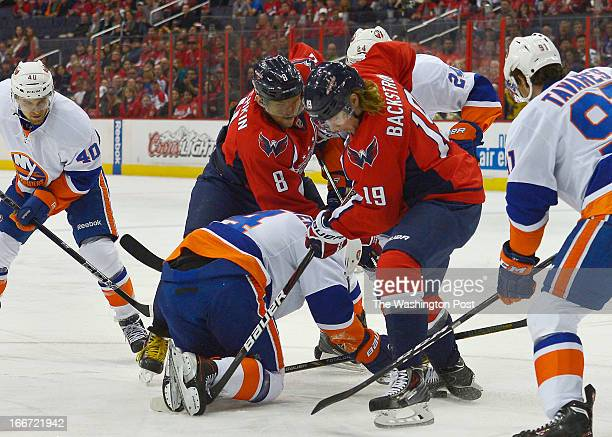 Washington Capitals left wing Alex Ovechkin and Washington Capitals center Nicklas Backstrom fight for the puck against the New York Islanders during...