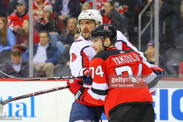 Washington Capitals left wing Alex Ovechkin battles New Jersey Devils defenseman Egor Yakovlev during the second period of the National Hockey League...