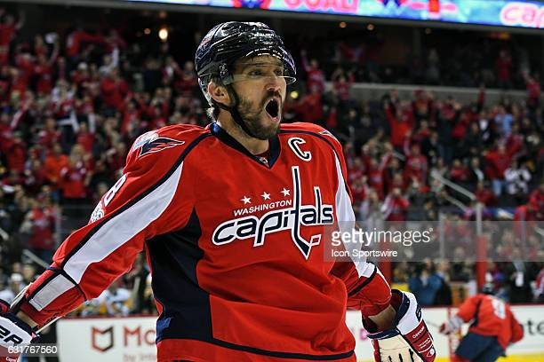 WASHINGTON DC JANUARY Washington Capitals left wing Alex Ovechkin celebrates after scoring his 1000th career point with a first period goal against...