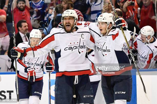 Washington Capitals left wing Alex Ovechkin celebrates with Washington Capitals left wing Andre Burakovsky after the seventh game of the NHL Stanley...