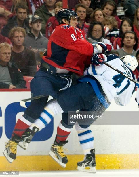 Washington Capitals left wing Alex Ovechkin checks Winnipeg Jets center Jason Jaffray during the second period at the Verizon Center in Washington DC...