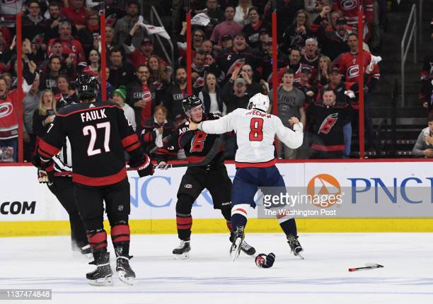 RALEIGH NC APRIL Washington Capitals left wing Alex Ovechkin gets ready to hit Carolina Hurricanes right wing Andrei Svechnikov as they fight during...