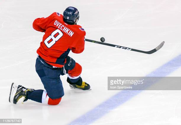 Washington Capitals left wing Alex Ovechkin goes to one knee to keep the puck in the zone on a third period power play against the Winnipeg Jets on...