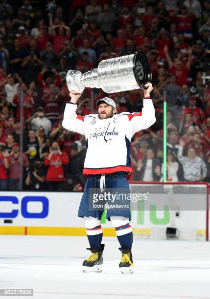 Washington Capitals Left Wing Alex Ovechkin hoists the Stanley Cup to celebrate defeating the Las Vegas Golden Knights 43 during game 5 of the...