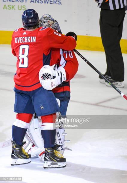 Washington Capitals left wing Alex Ovechkin hugs goaltender Braden Holtby following the game against the Detroit Red Wings on December 11 at the...