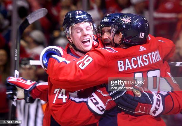 Washington Capitals left wing Alex Ovechkin is congratulated by defenseman John Carlson and center Chandler Stephenson after his second period goal...