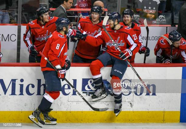Washington Capitals left wing Alex Ovechkin is congratulated by center Nic Dowd after his hat trick against the Detroit Red Wings on December 11 at...