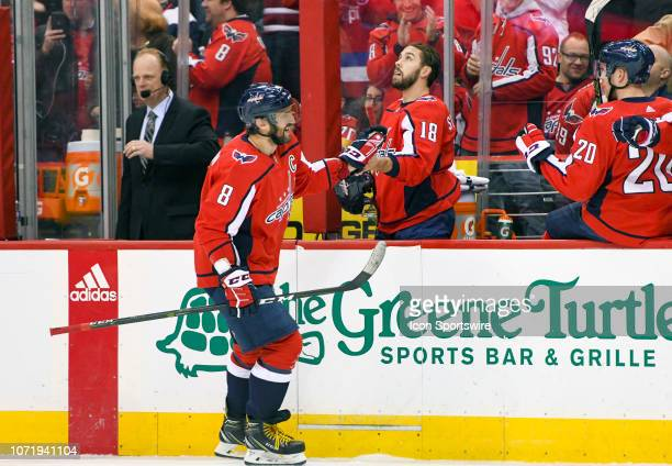 Washington Capitals left wing Alex Ovechkin is congratulated by center Chandler Stephenson after his first period goal against the Detroit Red Wings...
