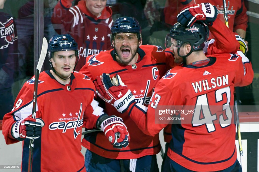 Washington Capitals left wing Alex Ovechkin (8) is congratulated by defenseman Dmitry Orlov (9) and right wing Tom Wilson (43) after scoring in the third period on February 20, 2018, at the Capital One Arena in Washington, D.C. The Tampa Bay Lightning defeated the Washington Capitals, 4-2.