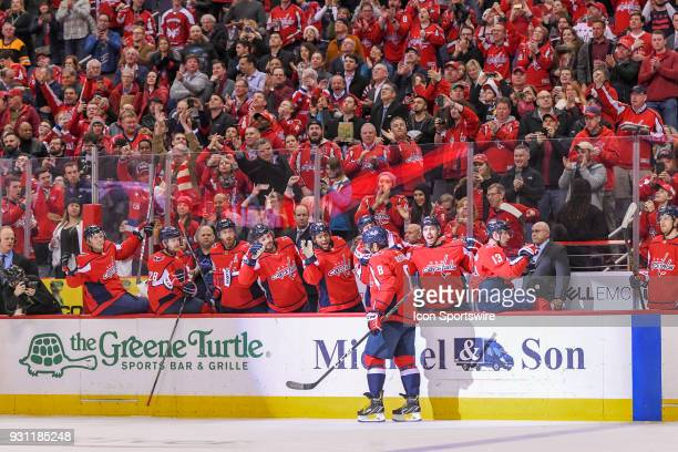Washington Capitals left wing Alex Ovechkin is congratulated by the bench after scoring his 600th NHL goal in the second period against the Winnipeg...