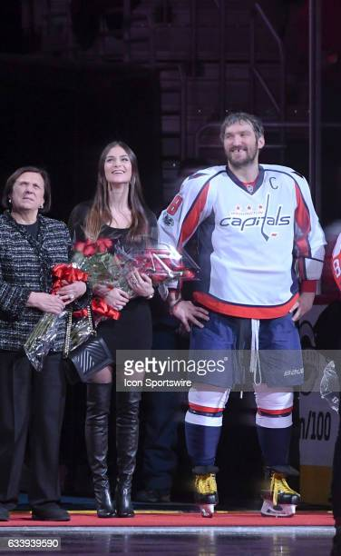 Washington Capitals left wing Alex Ovechkin is joined by his wife Nasty Shubskaya and his mother Tatyana as he is honored prior to the game for his...