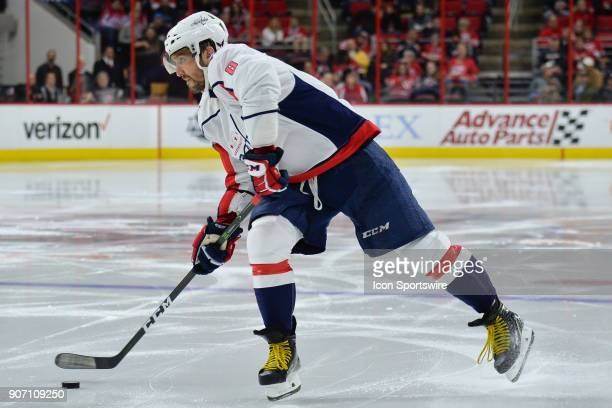 Washington Capitals Left Wing Alex Ovechkin loads up to shoot the puck during a game between the Washington Capitals and the Carolina Hurricanes at...