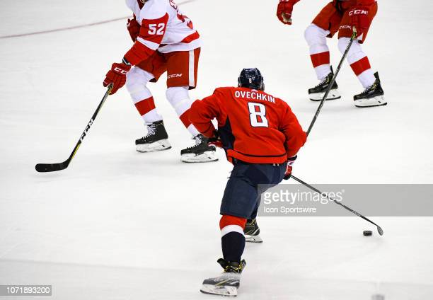 Washington Capitals left wing Alex Ovechkin moves the puck up ice against Detroit Red Wings defenseman Jonathan Ericsson in the third period on...