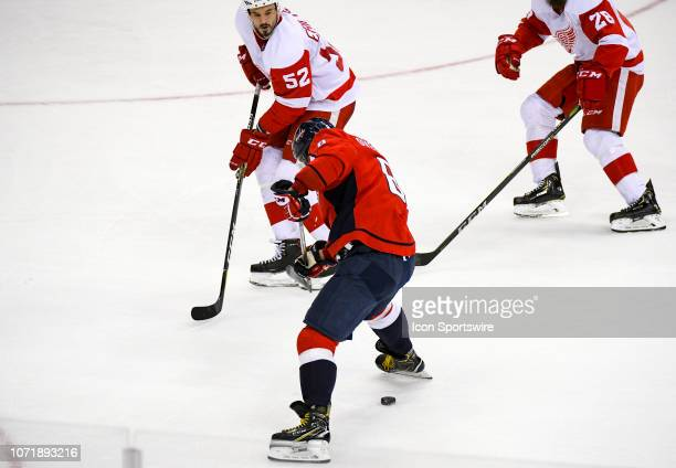 Washington Capitals left wing Alex Ovechkin moves the puck up ice between his legs against Detroit Red Wings defenseman Jonathan Ericsson in the...