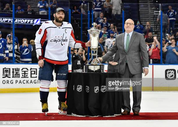 Washington Capitals left wing Alex Ovechkin poses with Deputy Commissioner Bill Daly and the Prince of Wales trophy after the seventh game of the NHL...