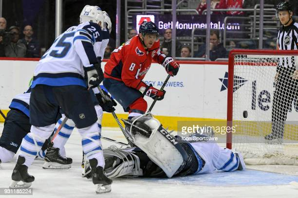 Washington Capitals left wing Alex Ovechkin scores his 600th NHL goal against Winnipeg Jets goaltender Connor Hellebuyck in the second period on...