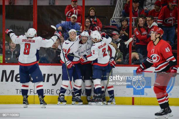 Washington Capitals Left Wing Alex Ovechkin skates in to celebrate with teammates after a goal during a game between the Washington Capitals and the...