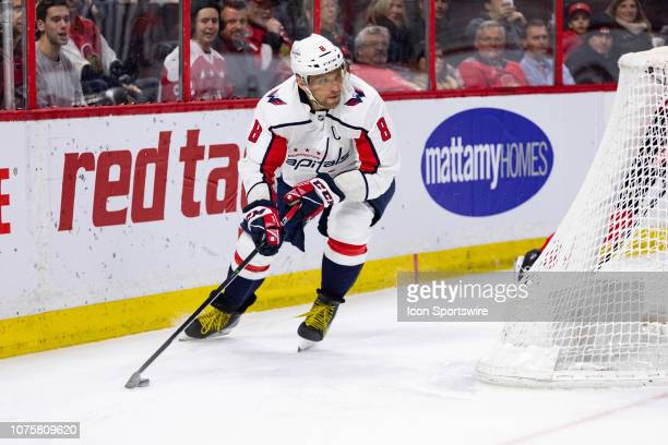 Washington Capitals Left Wing Alex Ovechkin skates the puck around the net during first period National Hockey League action between the Washington...