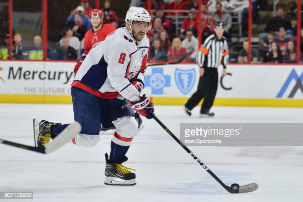 Washington Capitals Left Wing Alex Ovechkin skates with the puck with his tongue out during a game between the Washington Capitals and the Carolina...