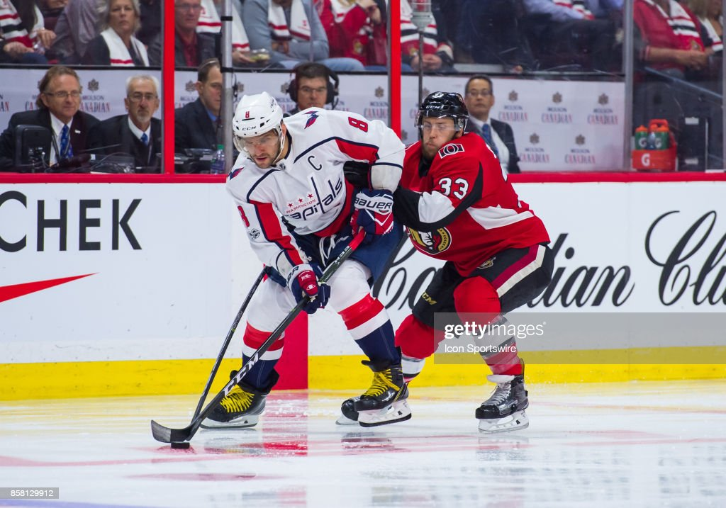 Washington Capitals Left Wing Alex Ovechkin (8) stickhandles the puck against Ottawa Senators Defenceman Fredrik Claesson (33) during the NHL game between the Ottawa Senators and the Washington Capitals on October 5, 2017 at the Canadian Tire Centre in Ottawa, Ontario, Canada.