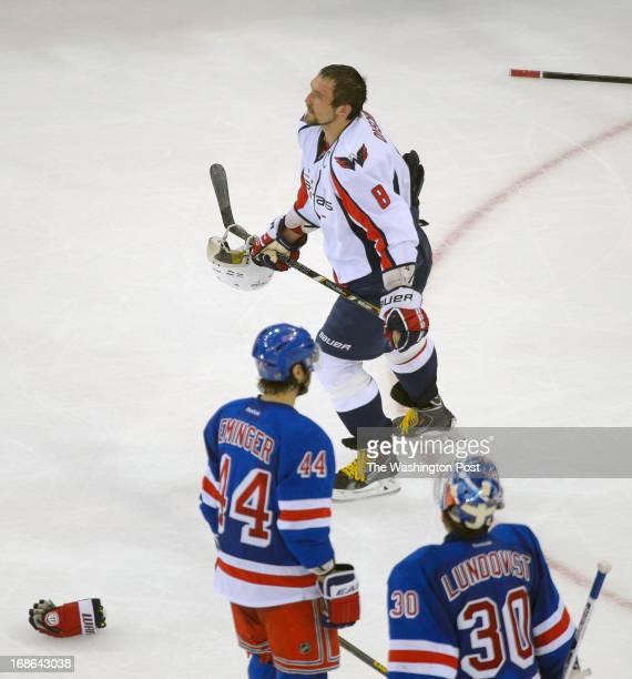 Washington Capitals left wing Alex Ovechkin top skates pas New York Rangers defenseman Steve Eminger left and New York Rangers goalie Henrik...