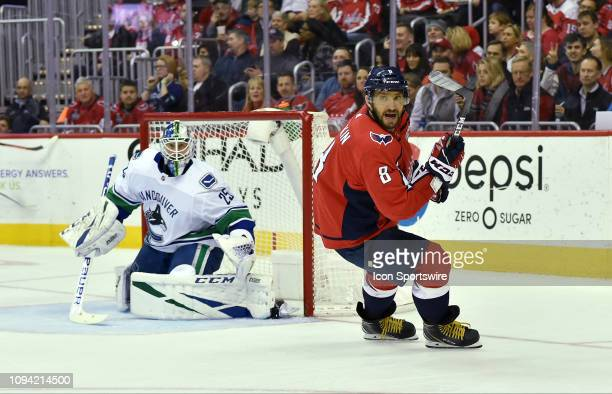 Washington Capitals left wing Alex Ovechkin turns in the offensive zone while Vancouver Canucks goalie Jacob Markstrom watches the puck during the...