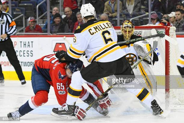 Washington Capitals left wing Andre Burakovsky is defended in front to the goal in the first period by Boston Bruins defenseman Colin Miller on...