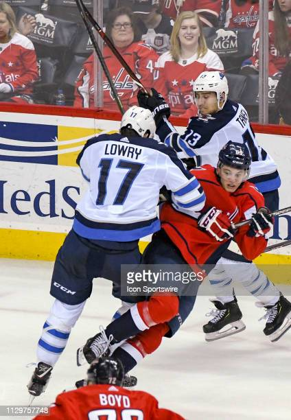 Washington Capitals left wing Andre Burakovsky is hit by Winnipeg Jets center Adam Lowry on March 10 at the Capital One Arena in Washington DC