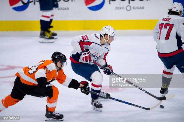Washington Capitals Left Wing Andre Burakovsky keeps the puck from Philadelphia Flyers Right Wing Matt Read in the first period during the game...