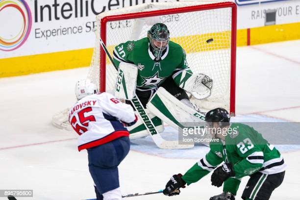 Washington Capitals left wing Andre Burakovsky scores the game winning goal past Dallas Stars goalie Ben Bishop in overtime of the hockey game...