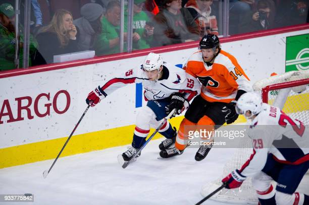 Washington Capitals Left Wing Andre Burakovsky tries to outrun Philadelphia Flyers Center Sean Couturier for the puck in the third period during the...